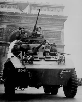 American troops in tank passing the Arc de Triomphe after the liberation of