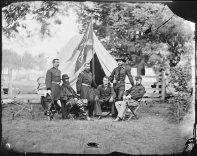 Mathew B Brady Collection of Civil War Photographs › B-60 General Philip Sheridan, General Wesley Merritt and Others, Including General Henry E. Davies? - Fold3.com