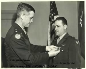 "REcieving his BRONZE STAR with ""V"" for VALOR."