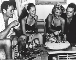 Errol Flynn, Nora Eddington, Rita Hayworth, Orson Wells