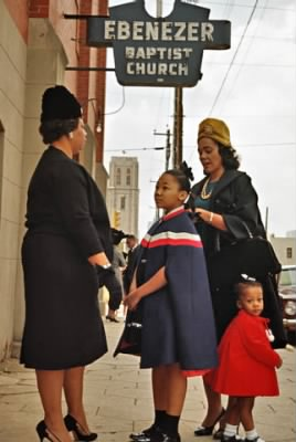 Coretta Scott King and her daughters, Yolanda and Bernice, talk with a fellow parishioner outside Ebenezer Baptist Church in Atlanta..jpg