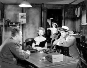 With Fred MacMurray (r.) in Borderline (1950).jpg