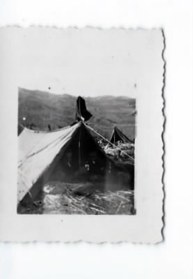 Little tiny pic of tent looks as if it is in war not sure.jpg