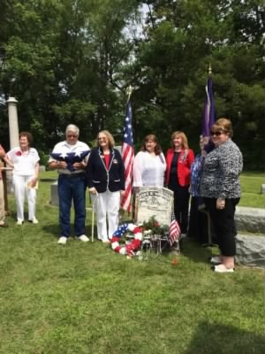 United States Daughters of the 1812  at Memorial Service Ezra Davis Barnes  Byron Michigan 2014 flag held by descendant Eilert Barnes from Whitimore Michigan.jpg